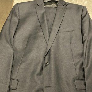 Calvin Klein two piece gray suit.  NEW With Tags